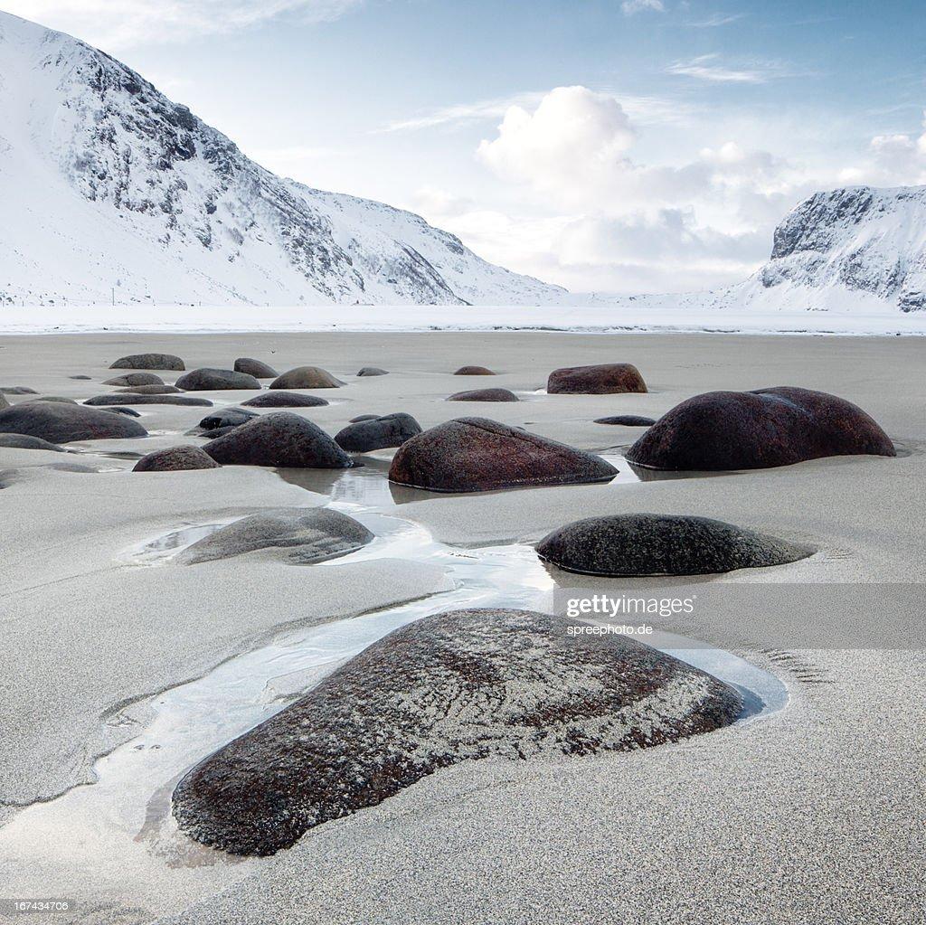 Norway lofoten unstad beach with stones : Foto de stock