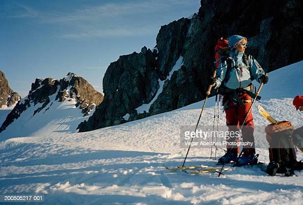 norway, lyngen alps, gervasstinden,randonee skiers resting - telemark stock pictures, royalty-free photos & images
