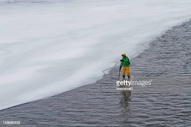 Norway, Narvik, Mature man paddling in polar ocean