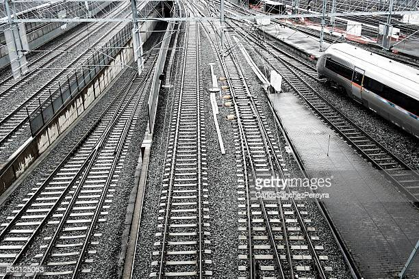 Norway, Oslo, Elevated view of railway tracks with passing high-speed train