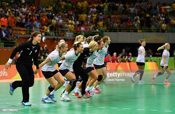 Norway players celebrate their victory following the Women's Handball Bronze medal match between Netherlands and Norway at Future Arena on Day 15 of...