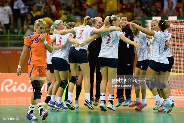 Norway players celebrate their victory while Estavana Polman of Netherlands looks dejected following the Women's Handball Bronze medal match between...