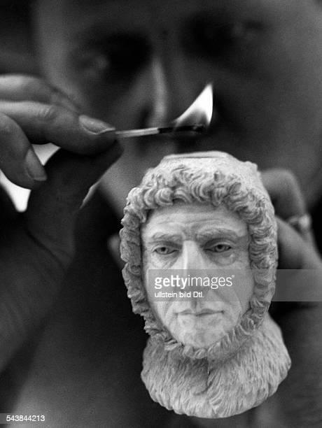 Norway Roald Engelbregt Gravning Amundsen as bowl of a tobaccopipe Photographer Martin Munkacsi Published by 'Berliner Illustrirte Zeitung'...