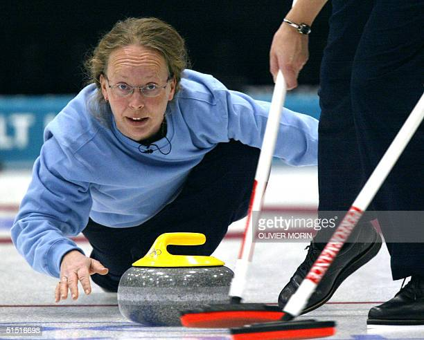 Norway 's skip Dordi Nordby throws the stone during their first round match of the women's curling against Great Britain 11 February 2002 at the...