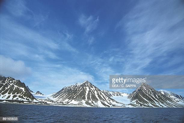 Norway Svalbard Islands cirrus clouds over Northwestern coast