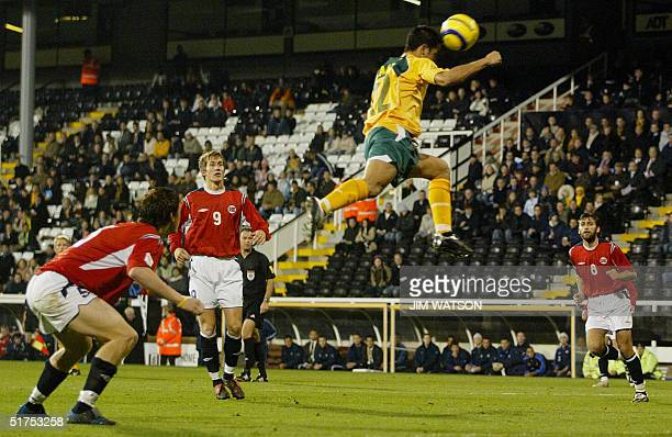 Norway team members look on as Australia's Tim Cahill jumps for a header during an International Friendly at Craven Cottage in London 16 November...