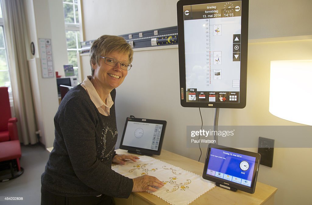 OSLO, Norway--Occupational therapist Sigrid Aketun meets with people suffering dementia at Alma's House to see if new technology like this oversized touch screen computer can help them libve at home longer. August 25, 2014.