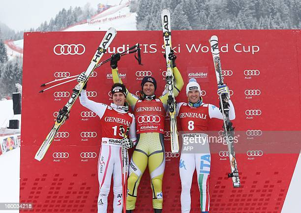 Norway's Aksel Lund Svindal celebrates his victory on the podium with Austria's Matthias Mayer and Italy's Christof Innerhofer after the men's World...