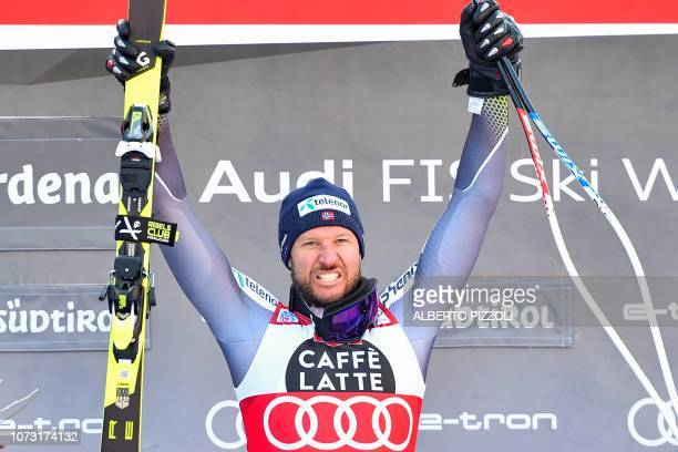 Norway's Aksel Lund Svindal celebrates on the podium after winning the FIS Alpine World Cup Men Super G on December 14 2018 in Val Gardena Groeden...
