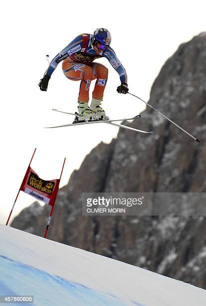 Norway's Aksel Lund Svindal competes during the FIS Alpine World Cup Men's Downhill during the second training session on December 19 2013 in Val...