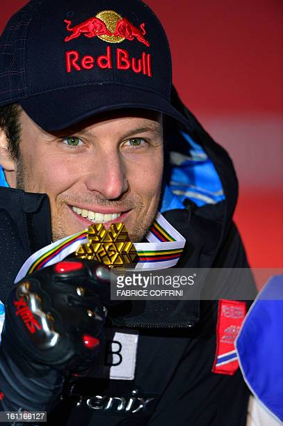 Norway's Aksel Lund Svindal poses with the gold medal after men's downhill event of the 2013 Ski World Championships in Schladming Austria on...