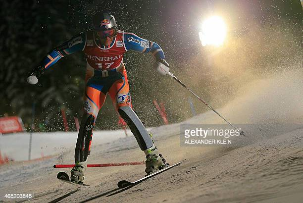 Norway's Aksel Lund Svindal reacts as he misses a gate during the FIS men's Alpine ski World Cup Super Combined Slalom race in Kitzbuehel on January...