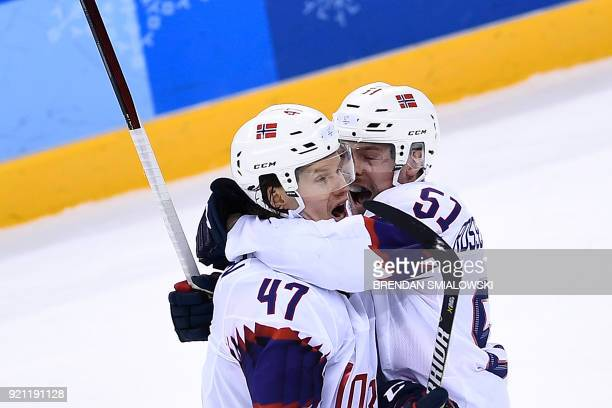 Norway's Alexander Bonsaksen and Norway's Mats Rosseli Olsen celebrate after an overtime win of a men's quarterfinals playoffs ice hockey match...