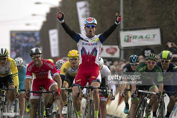 Norway's Alexander Kristoff celebrates as he crosses the finish line ahead of France's Nacer Bouhanni and France's Bryan Coquard at the end of the...