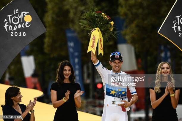 Norway's Alexander Kristoff celebrates on the podium after winning the 21st and last stage of the 105th edition of the Tour de France cycling race...