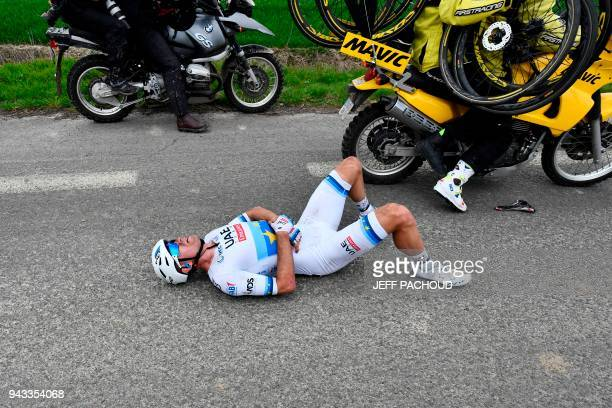 Norway's Alexander Kristoff lies on the ground after a fall during the 116th edition of the ParisRoubaix oneday classic cycling race between...