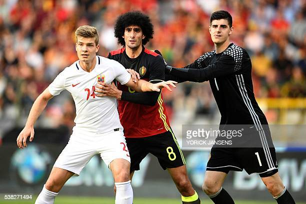 OUT*** Norway's Alexander Sorloth Belgium's Marouane Fellaini and Belgium's goalkeeper Thibaut Courtois look on during the friendly football match...