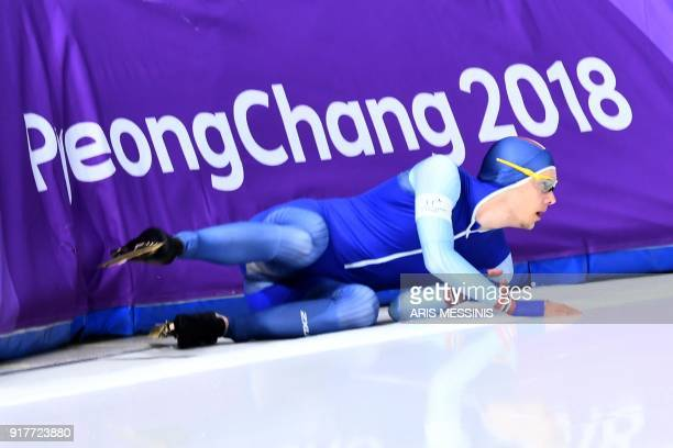 Norway's Allan Dahl Johansson falls in the men's 1500m speed skating event during the Pyeongchang 2018 Winter Olympic Games at the Gangneung Oval in...