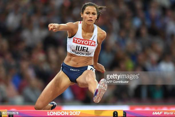 Norway's Amalie Iuel competes in the heats of the women's 400m hurdles athletics event at the 2017 IAAF World Championships at the London Stadium in...