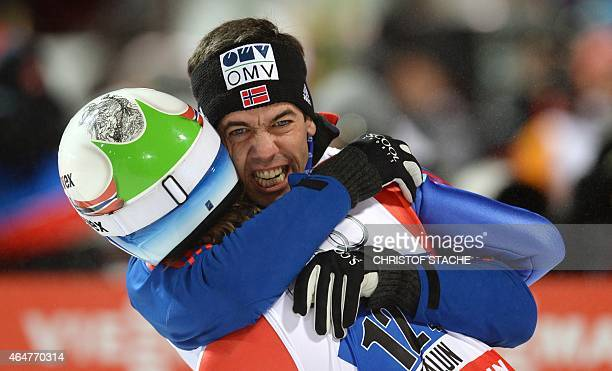 Norway's Anders Bardal and his compatriot Rune Velta celebrate after the Men Large Hill Team competition of the 2015 FIS Nordic World Ski...