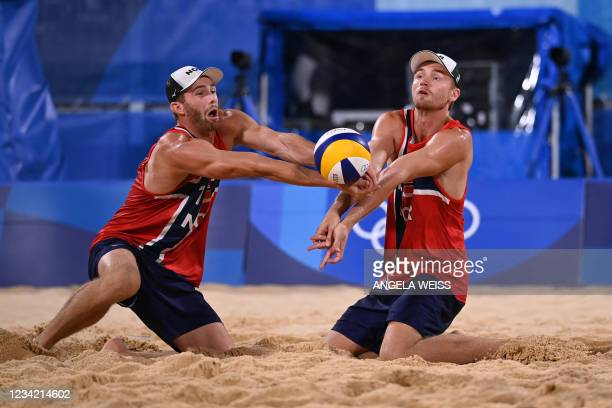 Norway's Anders Berntsen Mol and Norway's Christian Sandlie Sorum vie for the ball in their men's preliminary beach volleyball pool A match between...