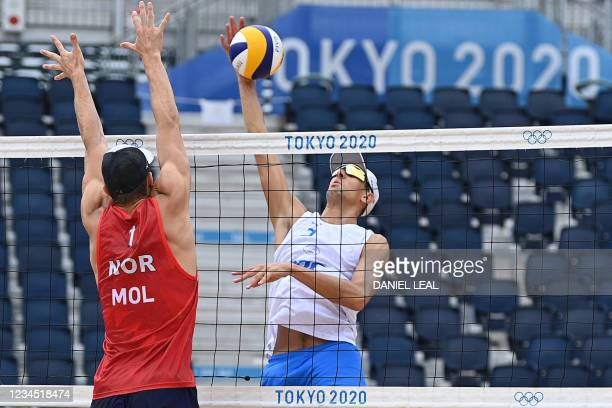 Norway's Anders Berntsen Mol blocks a shot by Russia's Oleg Stoyanovskiy in their men's beach volleyball final medal match between Norway and Russia...
