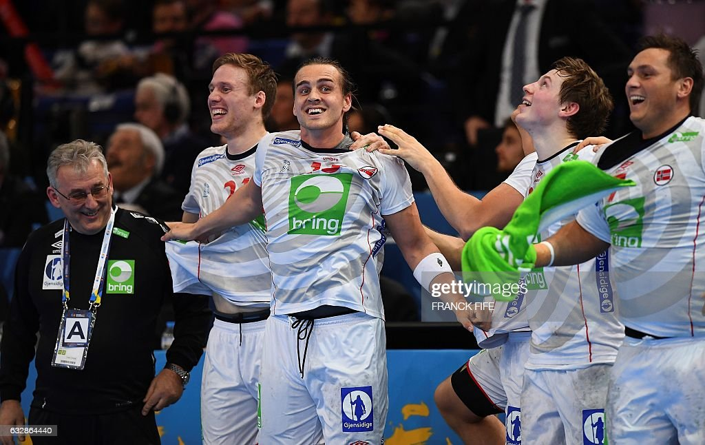 Norway's assistant coach Zeljko Tomac, Norway's pivot Magnus Gullerud, Norway's right back Kent Robin Tonnesen, Norway's centre back Goran Johannessen and Norway's pivot Joakim Hykkerud celebrate after winning the 25th IHF Men's World Championship 2017 semi-final handball match Croatia vs Norway on January 27, 2017 at the Accorhotels Arena in Paris. / AFP / FRANCK