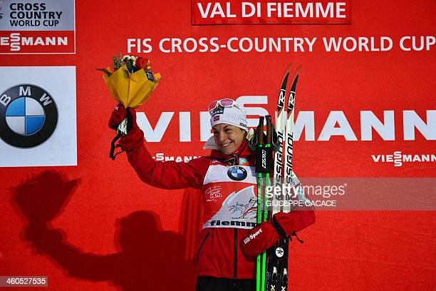 Norway's Astrid Uhrenholdt Jacobsen second celebrates on the podium of the 5km Classic of the sixth stage of the ladies Nordic Skiing Tour de Ski in...