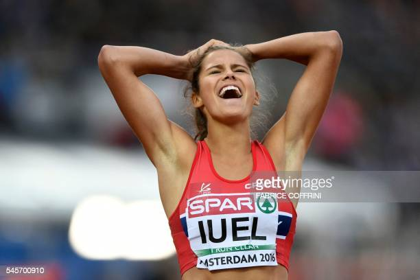 Norway's athlete Amalie Hammild Iuel reacts after competing on the Women's 400m hurdles semifinal during the European Athletics Championships at the...
