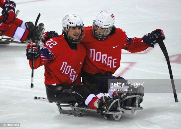 Norway's Audun Bakke celebrates a goal with teammates against Japan during the ice hockey classification game between Norway and Japan at the...