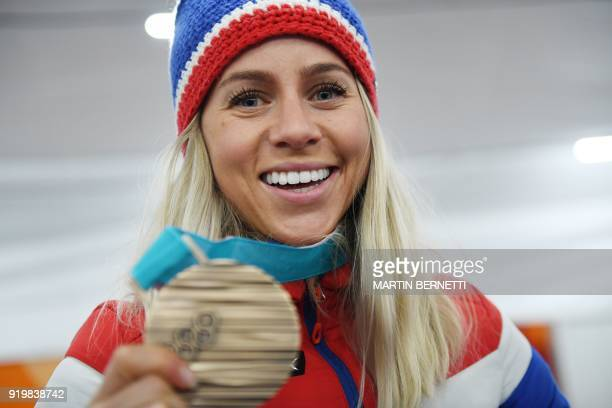 TOPSHOT Norway's biathlon 125km mass start bronze medallist Tiril Eckhoff poses backstage at the Athletes' Lounge during the medal ceremonies at the...