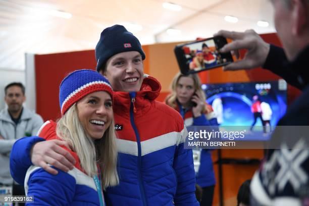 Norway's biathlon 125km mass start bronze medallist Tiril Eckhoff poses for a picture with Norway's ski slopestyle gold medallist Oystein Braaten...