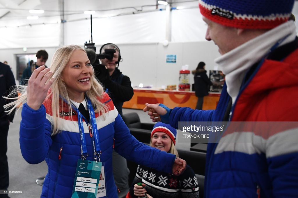 Norway's biathlon medallist Johannes Thingnes Boe (R) greets Norway's alpine skiing downhill silver medallist Ragnhild Mowinckel backstage at the Athletes' Lounge during the medal ceremonies at the Pyeongchang Medals Plaza during the Pyeongchang 2018 Winter Olympic Games in Pyeongchang on February 21, 2018. /