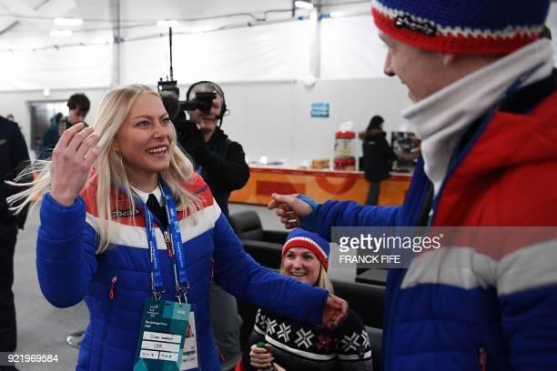 Norway's biathlon medallist Johannes Thingnes Boe greets Norway's alpine skiing downhill silver medallist Ragnhild Mowinckel backstage at the...