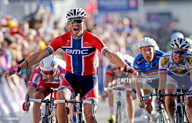 Norway's BMC Racing Team rider Thor Hushovd celebrates as he wins the second stage of the Arctic Race of Norway on August 9 2013 in Svolvaer Norway...