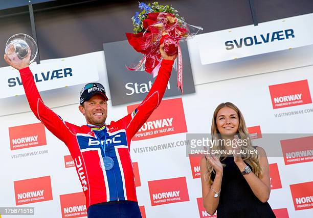 Norway's BMC Racing Team rider Thor Hushovd celebrates on the podium after winning the second stage of the Arctic Race of Norway on August 9 2013 in...