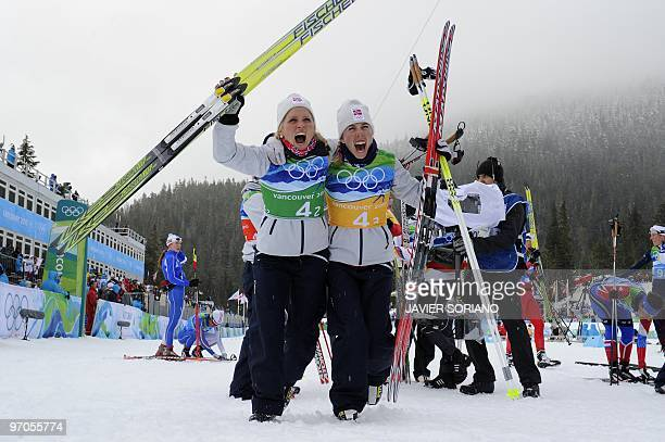 Norway's bronze medalists Therese Johaug and Kristin Stoemer Steira react after the women's Cross Country Skiing 4x5 km relay at Whistler Olympic...