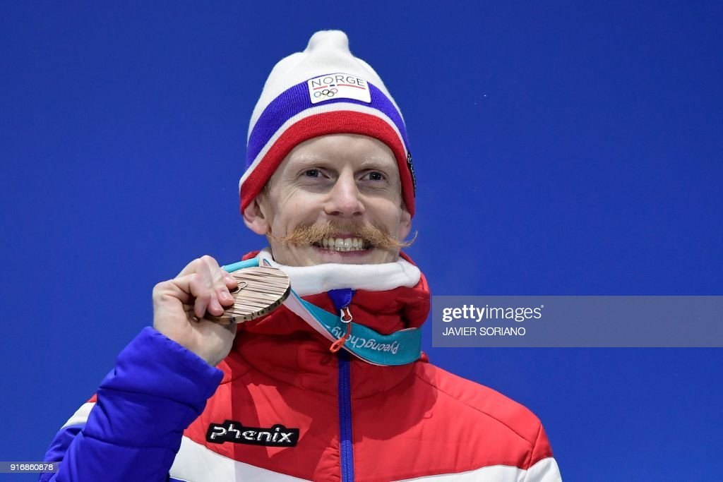 Norway's bronze medallist Johann Andre Forfang poses on the podium during the medal ceremony for the ski jumping Men's Normal Hill Individual at the Pyeongchang Medals Plaza during the Pyeongchang 2018 Winter Olympic Games in Pyeongchang on February 11, 2018. /