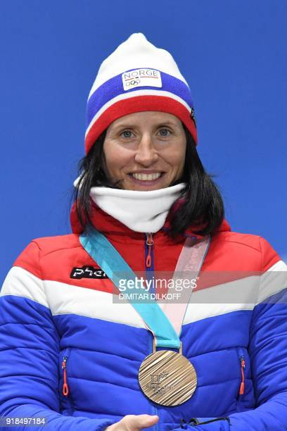 Norway's bronze medallist Marit Bjoergen poses on the podium during the medal ceremony for the cross country women's 10km Free at the Pyeongchang...