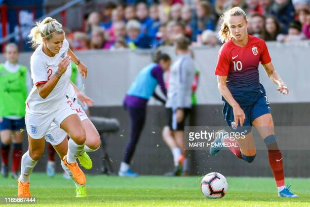 Norway´s Caroline Graham Hansen and England's Rachel Daly vie for the ball during the women friendly football match between Norway vs England at...
