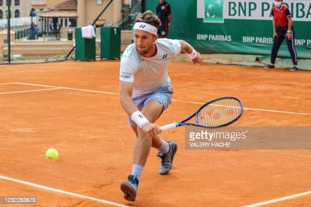 Norway's Casper Ruud backhands the ball to Denmark's Holger Rune during their first round singles match on day three of the Monte-Carlo ATP 1000...