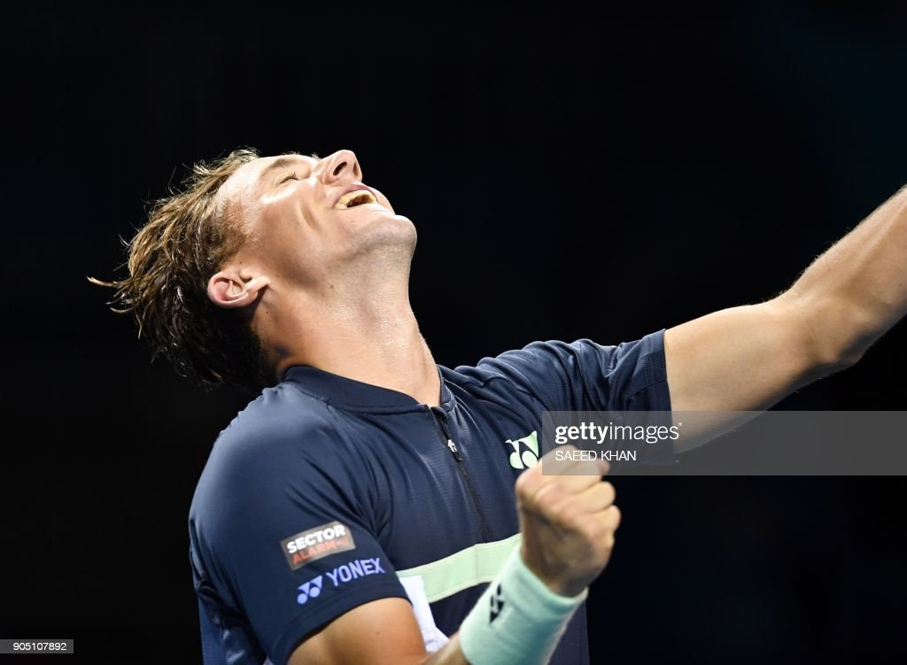 TOPSHOT - Norway's Casper Ruud celebrates after victory over France's Quentin Halys in their men's singles first round match on day one of the Australian Open tennis tournament in Melbourne on January 15, 2018. /