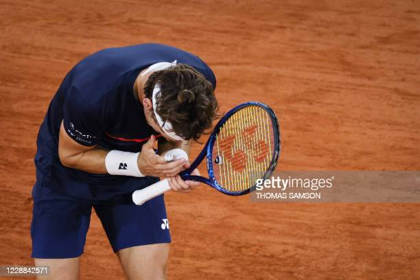 Norway's Casper Ruud reacts as he plays against Austria's Dominic Thiem during their men's singles third round tennis match on Day 6 of The Roland...