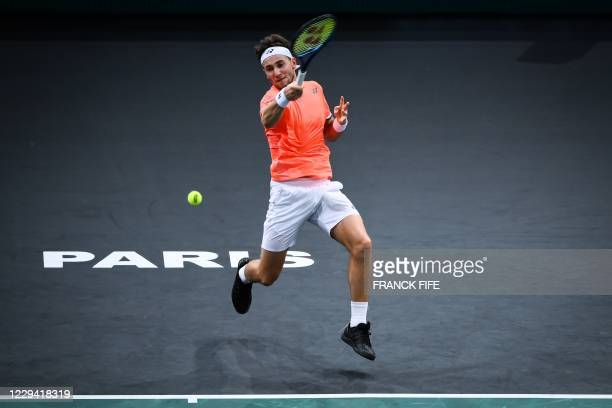 Norway's Casper Ruud returns the ball to France's Ugo Humbert during their men's singles first round tennis match on day 1 at the ATP World Tour...
