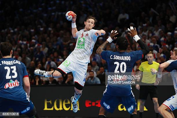 Norway's centre back Sander Sagosen attempts a shot on goal over France's pivot Cedric Sorhaindo during the 25th IHF Men's World Championship 2017...