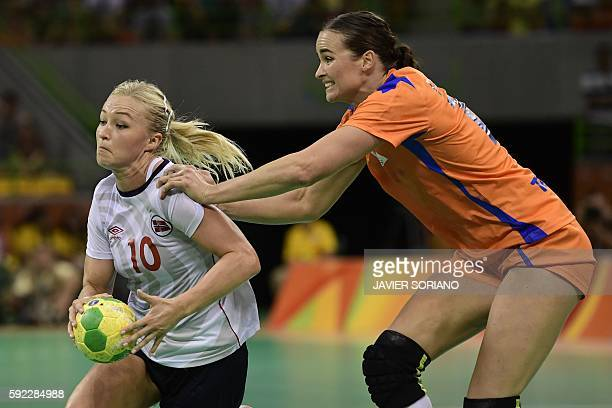 Norway's centre back Stine Bredal Oftedal vies with Netherlands' pivot Yvette Broch during the women's Bronze Medal handball match Netherlands vs...