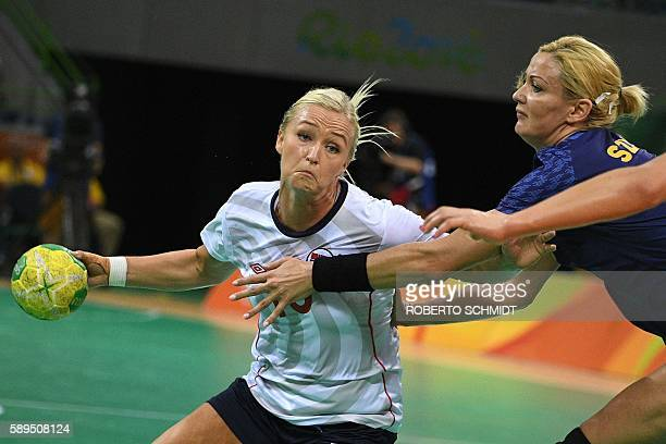 Norway's centre back Stine Bredal Oftedal vies with Romania's right back Gabriella Szucs during the women's preliminaries Group A handball match...