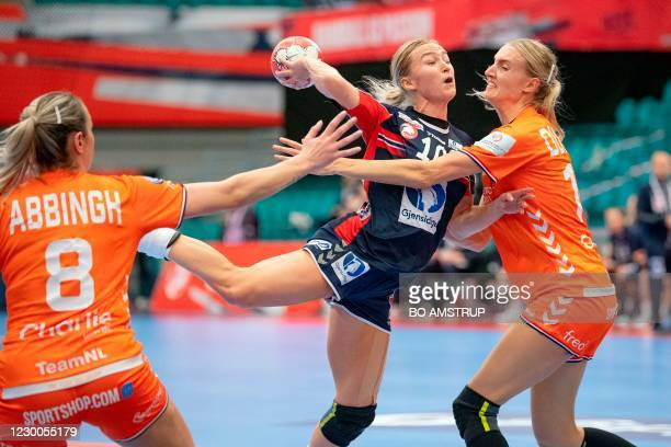 Norway's Centre back Stine Oftedal vies for the ball with Netherlands' Left back Kelly Dulfer and Netherlands' Left back Lois Abbingh during the main...