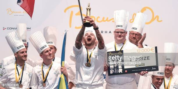 Norway's chef Christian Andre Pettersen holds the first prize trophy as he celebrates with team mates on the podium of the Europe 2018 Bocuse d'Or...