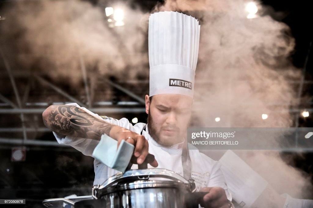 Norway's Christian Andre Pettersen competes during the event of the Bocuse d'Or Europe 2018 International culinary competition, on June 12, 2018 in Turin.